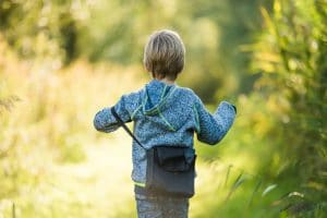 Boy walking in Biesbosch woods