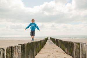 Boy on the beach in Holland