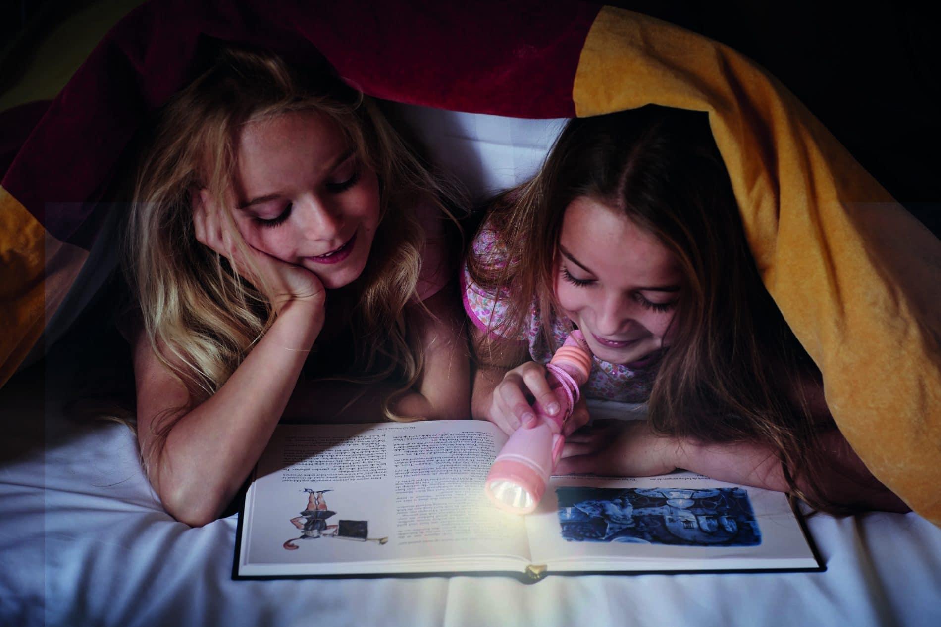 Children reading by torch light
