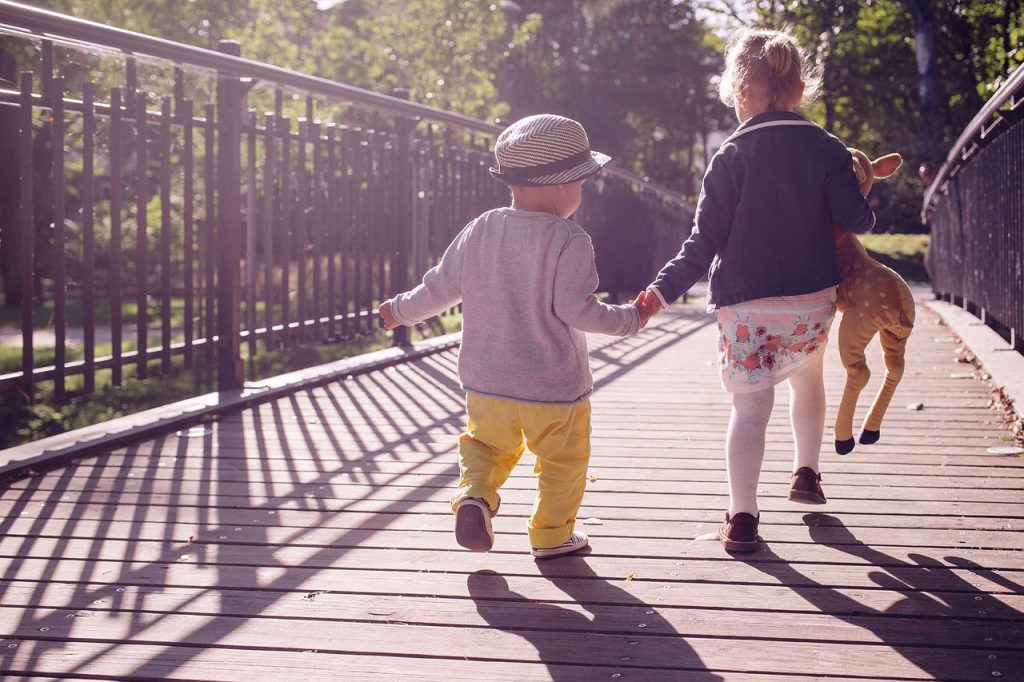 toddlers on a bridge on a sunny day