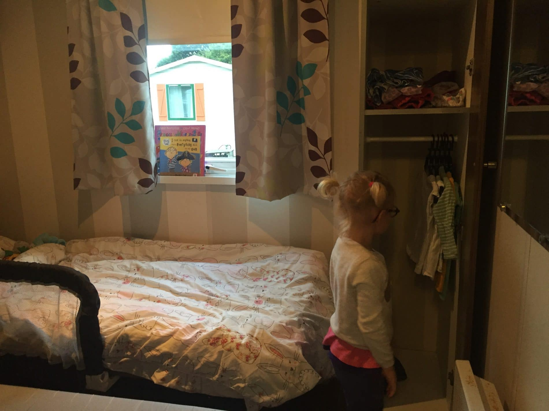 Toddler organising her room at Duinrell
