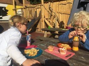 Children eating on terrace at Kinderkookkafe Amsterdam